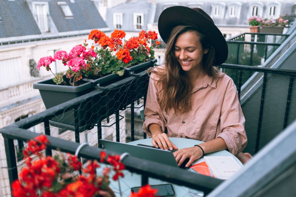 Lady thats typing on balcony
